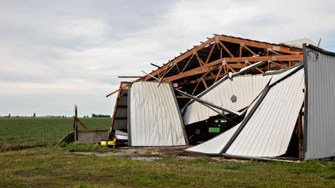 FRANKLIN GROVE, IL - AUGUST 10:  A John Deere agricultural tractor sits under a collapsed building following a derecho storm, a widespread wind storm associated with a band of rapidly moving showers or thunderstorms, on August 10, 2020 near Franklin Grove, Illinois. The storm moved across the Midwest with winds recorded near 100 mph in Iowa and Illinois. (Photo by Daniel Acker/Getty Images)