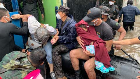 More than 30 people had to be rescued by boats from the flooding caused by intense rains from Tropical Storm Amanda on Sunday, May 31, 2020, in El Salvador. (Twitter/@SecPrensaSV)