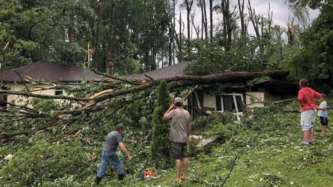 A home on Red Hill Road in Ellettsville, Indiana, is smashed under a tree that fell during storms on Saturday, June 15, 2019. (Instagram/Britterfigg)