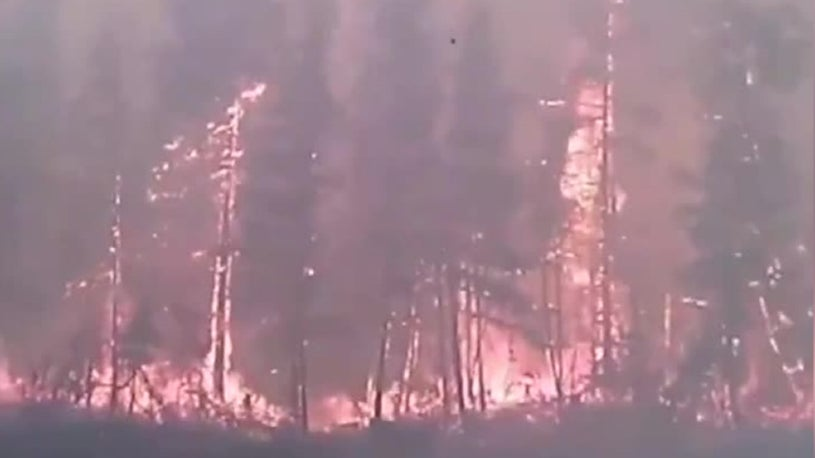 Desperate Arctic Villagers Flee Raging Wildfire on Boats