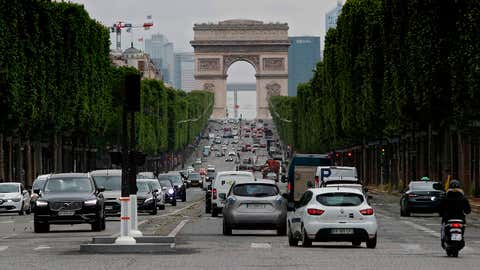 Cars drive on the Champs Elysees in Paris on Monday, May 11, 2020, on the first day of France's easing of lockdown measures in place for 55 days to curb the spread of the COVID-19 pandemic, caused by the novel coronavirus. (Photo by THOMAS COEX/AFP via Getty Images)