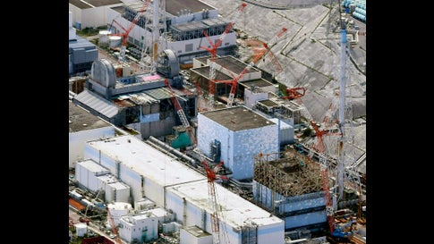 FILE - This Sept. 4, 2017, aerial file photo shows Fukushima Dai-ichi nuclear power plant reactors, bottom from right, Unit 1, Unit 2 and Unit 3, in Okuma town, Fukushima prefecture, northeastern Japan. The utility company operating Fukushima's tsunami-wrecked nuclear power plant said Friday, Aug. 9, 2019 it will run out of space for tanks to store massive amounts of treated but still contaminated water in three years, adding pressure for the government and the public to reach consensus on what to do with the water. (Daisuke Suzuki/Kyodo News via AP, File)