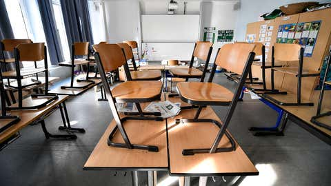 Chairs are stacked on tables of a classroom at a closed primary school in Gelsenkirchen, Germany, on Monday, March 16, 2020. In order to slow down the spread of the coronavirus, Germany's most populated state, North Rhine-Westphalia, closed all schools and daycare centers. (AP Photo/Martin Meissner)