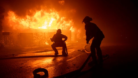 Firefighters try to save a home on Tigertail Road during the Getty Fire, Monday, October 28, 2019, in Los Angeles. (AP Photo/ Christian Monterrosa)