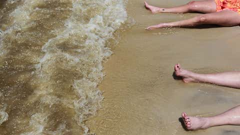 Vibrio vulnificus is a naturally occurring bacteria in warm, brackish seawater. It can enter a person's skin through a cut or a scrape. (Joe Raedle/Getty Images)