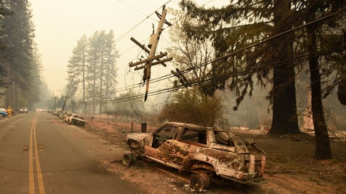 Abandoned vehicles sit on the side of a road in Paradise, California, on November 9, 2018. The Camp Fire nearly wiped out the town and killed 86 people. (Josh Edelson/AFP/Getty Images)