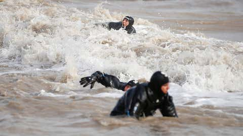 Rescue teams, composed of ten personnel of Gendarmerie Commando Special Public Security Command, three personnel of Underwater Search Unit of Antalya Provincial Gendarmerie Command and five divers of Antalya Police Department, search for a missing 20-year-old university student Kader Buse Acar who was swept away by rushing floodwaters in Antalya, Turkey, on Jan. 25, 2019. (Mustafa Ciftci/Anadolu Agency/Getty Images)