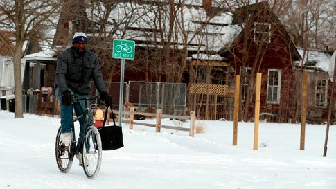 Jerry Jackson rides his bike on a cold day on Cochrane Street on Jan. 29, 2019, in Detroit, Mich., after Winter Storm Jayden hit the area. Millions of Americans braced Tuesday for a dangerous polar vortex which began to settle over a large swath of the United States, threatening to set new records as schools and businesses closed and authorities warned of frostbite. Temperatures in almost a dozen states stretching over 1,200 miles from the Dakotas to Ohio were forecast to be the coldest in a generation, if not on record. (Jeff Kowalsky/AFP/Getty Images)