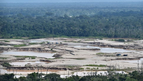 An aerial view over a chemically deforested area of the Amazon jungle caused by illegal mining activities in the river basin of the Madre de Dios region in southeast Peru, during the 'Mercury' joint operation by Peruvian military and police on February 19, 2019. According to authorities, illegal mining activities for gold have caused irreversible ecological damage to more than 11,000 hectares of Amazonian forest and river basins. (Cris Bouroncle/AFP/Getty Images)