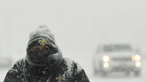 Dawn Arnold waits for her bus as snow continues to fall on Feb. 6, 2019 in Denver, Colo. Cold temperatures and snow are in the forecast the next few days in the Denver area. (RJ Sangosti/MediaNews Group/The Denver Post via Getty Images)