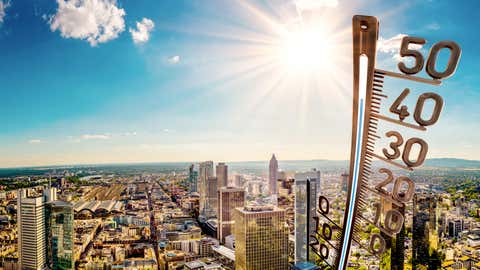 Panorama of Frankfurt am Main on a hot summer day with bright sun and big thermometer