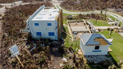 Damaged homes lie in ruin on Elbow Key Island on Sunday, September 8, 2019, in Hope Town on Elbow Key in the Bahamas. (Jose Jimenez/Getty Images)