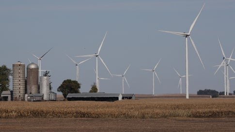 RIPPEY, IOWA - OCTOBER 14: Wind turbines are seen in a corn field behind a farm on October 14, 2019 in Rippey, Iowa. The 2020 Iowa Democratic caucuses will take place on February 3, 2020, making it the first nominating contest in the Democratic Party presidential primaries. (Photo by Joe Raedle/Getty Images)