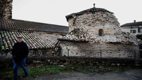 A man passes by a collapsed church tower in Le Teil, southeastern France, on November 11, 2019, after an earthquake with a magnitude of 4.8 hit the area. (Jeff Pachoud/AFP via Getty Images)
