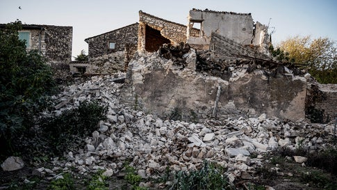 Residents inspect the damage and fallen masonry in the Rouviere quarter of Le Teil, southeastern France, on November 12, 2019, after an earthquake struck the area. (Jeff Pachoud/AFP via Getty Images)