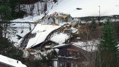 A landslide pushed one house into another on Monday, November 18, 2019, in Bad Gastein, south of Salzburg, Austria. Two women were injured. (AFP via Getty Images)