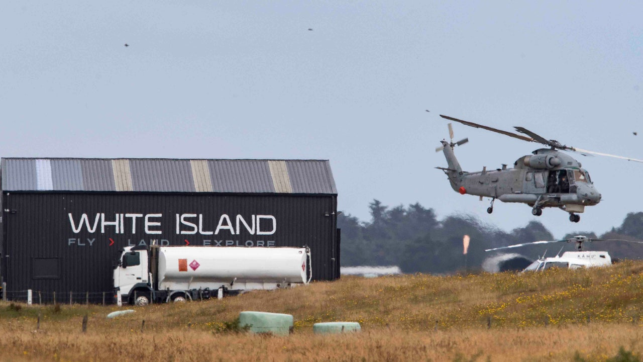 The New Zealand military has launched a risky operation to recover bodies from White Island.