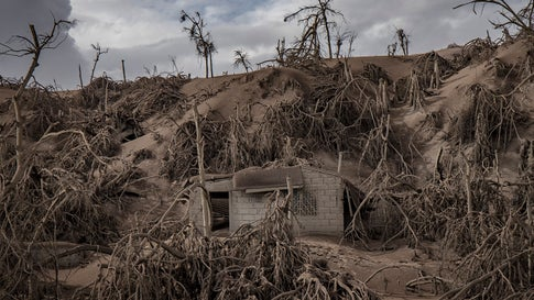 A house near Taal Volcano's crater is seen buried in volcanic ash on Tuesday, January 14, 2020, from the volcano's eruption on Taal Volcano Island, Batangas province, Philippines. (Photo by Ezra Acayan/Getty Images)