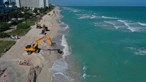 MIAMI BEACH, FLORIDA - JANUARY 14: An aerial view from a drone shows as construction work by the U.S. Army Corps of Engineers distributes sand along the beach on January 14, 2020 in Miami Beach, Florida. The project is part of a $16 million dollar project funded by the federal government to use a total of 61,000 tons of sand to widen the beaches in an effort to fight erosion and protect properties from storm surges. (Photo by Joe Raedle/Getty Images)