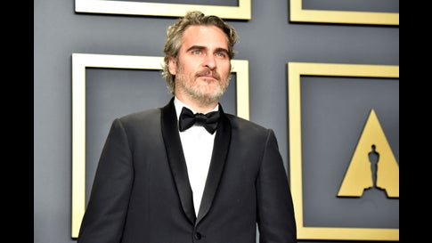 """Joaquin Phoenix, winner of the Actor in a Leading Role award for """"Joker,"""" poses in the press room during the 92nd Annual Academy Awards at Hollywood and Highland on February 09, 2020 in Hollywood, California. He's been wearing the same outfit all award season for environmental reasons. (Jeff Kravitz/FilmMagic)"""