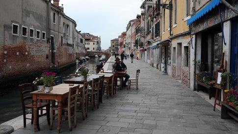 "A Venetian sits outside the historical cafe called 'The lost Paradise' at the fondamenta della Misericordia on March 9, 2020, in Venice, Italy. Prime Minister Giuseppe Conte announced a ""national emergency"" due to the coronavirus outbreak and imposed quarantines on the Lombardy and Veneto regions, which contain roughly a quarter of the country's population. Italy has the highest number of cases and fatalities in Europe. The movements in and out are allowed only for work reasons, health reasons proven by a medical certificate.The justifications for the movements needs to be certified with a self-declaration by filling in forms provided by the police forces in charge of the checks. (Marco Di Lauro/Getty Images)"