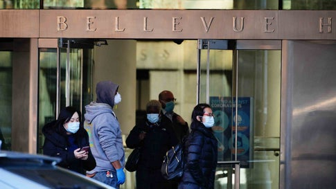 A view of people wearing masks in Bellevue Hospital amid the coronavirus (COVID-19) outbreak on March 24, 2020 in New York City (Photo by John Nacion/NurPhoto via Getty Images)