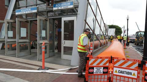 BOSTON - AUGUST 4: MBTA employees place Tiger Dam System Barriers around Boston's Aquarium T-Stop, in anticipation of Hurricane Isaias, on Aug. 4, 2020. (Photo by Jonathan Wiggs/The Boston Globe via Getty Images)