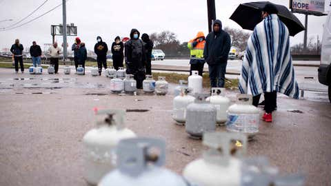 HOUSTON, TX - FEBRUARY 17: Propane tanks are placed in a line as people wait for the power to turn on to fill their tanks in Houston, Texas on February 17, 2021.