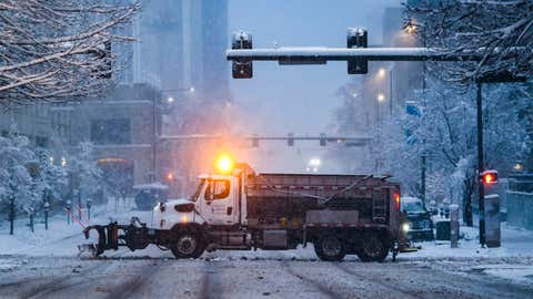DENVER, CO - MARCH 14: A snow plow clears a road on March 14, 2021 in Denver, Colorado. More than 1800 flights into and out of Denver have been canceled this weekend and highways around the state have been closed down as a winter storm hits the state. (Photo by Michael Ciaglo/Getty Images)