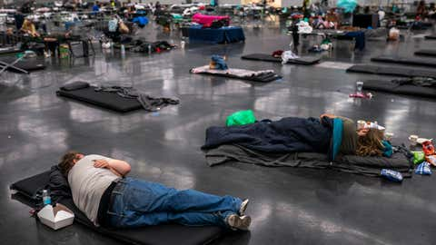Portland residents fill a cooling center with a capacity of about 300 people at the Oregon Convention Center on June 27, 2021, in Portland, Ore. Record breaking temperatures lingered over the Northwest during a historic heatwave this weekend. (Nathan Howard/Getty Images)