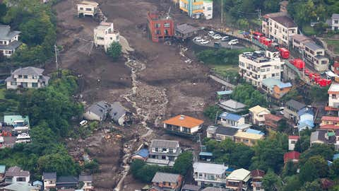 An aerial view from a Jiji Press helicopter shows the landslide site in Atami City, Shizuoka Prefecture, Japan, on July 5, 2021. (STR/JIJI PRESS/AFP via Getty Images)