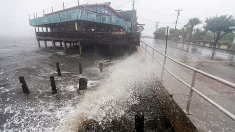 Tropical Storm Elsa creates large waves on July 7, 2021, in Cedar Key, Fla. A warning is in effect for a 200-mile stretch of Florida's gulf coastline as the storm makes landfall. After hitting Cuba on Monday, causing flooding and mudslides, Elsa is expected to pass over the states of Georgia and South Carolina in the coming days. (Mark Wallheiser/Getty Images)