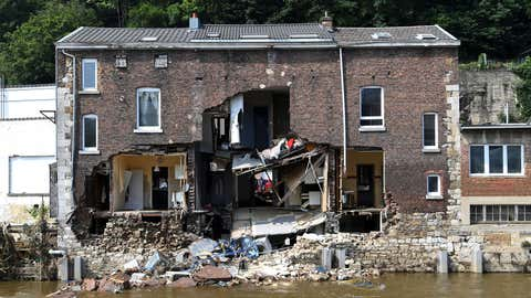 This picture, taken in Pepinster, near Liege, Belgium, on July 19, 2021, shows a destroyed building after heavy rains and flooding across areas of France, Belgium, Germany and The Netherlands. Rescue workers scrambled to find survivors and victims of the devastation wreaked by the worst floods to hit western Europe in living memory, which have already left more than 150 people dead and dozens more missing. (John Thys/AFP via Getty Images)