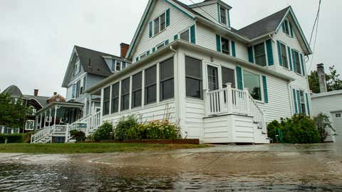 Water floods a home and the street around it during Tropical Storm Henri in Groton, Conn., on Aug. 22, 2021. (Joseph Prezioso/AFP via Getty Images)