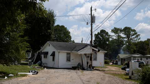 A damaged house that was moved by floodwaters sits in the middle of a street on Monday, Aug. 23, 2021, in Waverly, Tennessee. (Brett Carlsen/Getty Images)