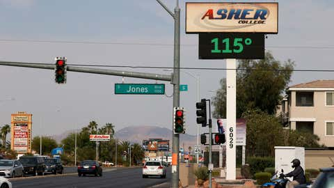 A digital sign displays a temperature of 115 degrees Fahrenheit as a heat wave continues to bake the Southwest United States on June 17, 2021, in Las Vegas, Nev. (Ethan Miller/Getty Images)