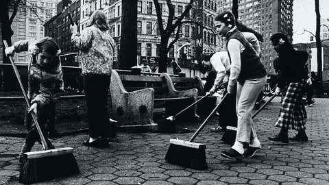Children sweep a city park during a 1970s Earth Day event in New York. (Hulton Archive/Getty Images)
