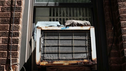NEW YORK, NY - AUGUST 20:  An air conditioner is viewed in a window at Brighton Beach in Brooklyn on August 20, 2015 in New York City. The National Oceanic and Atmospheric Administration (NOAA) announced on Thursday that July was the planet's warmest month on record. July's average temperature was 61.86 degrees Fahrenheit, beating the previous global mark set in 1998 and 2010 by about one-seventh of a degree. NOAA  began keeping records in1880.  (Photo by Spencer Platt/Getty Images)