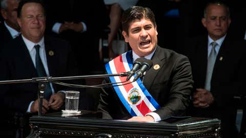 Costa Rica's President Carlos Alvarado announced at his inauguration on May 8, 2018, that by 2021 the country would start to implement a plan to end fossil fuel use in transportation. He arrived at the ceremony aboard a hydrogen-fueled bus. (Ezequiel Becerra/AFP/Getty Images)