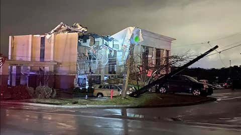 A Hampton Inn hotel is severely damaged after a tornado tore through Fultondale, Alabama, on Monday, January 25, 2021.  (Alicia Elliott via AP)