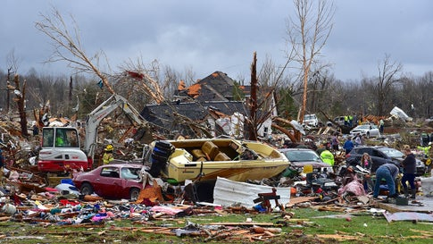 A boat rests on a car amid the total destruction of a home just off Locust Grove Road about 200 yards south of Highway 70 on the west edge of Cookeville, Tenn. (Jack McNeely/Cookeville Herald-Citizen)