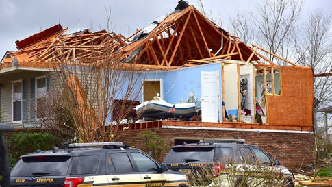 A second-floor bedroom is exposed in a home that was nearly destroyed by a tornado on Tuesday, March 3. 2020, in Cookeville, Tenn. At least 17 people died in surrounding Putnam County. (Jack McNeely/Cookeville Herald-Citizen)