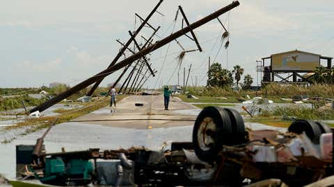 People survey the damage left in the wake of Hurricane Laura on Thursday, August 27, 2020, in Holly Beach, Louisiana. (AP Photo/Eric Gay)