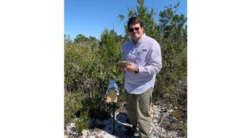 Dr. Chase Kimmel poses with Florida's ultra-rare calamintha bee in central Florida in spring 2020. (Courtesy: Dr. Chase Kimmel)