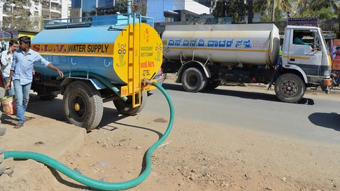 Tankers deliver water to apartments in Bengaluru, India, on February 27, 2018. The pace of building in India's technology hub has greatly outpaced the water system's ability to keep up. (Manjunath Kiran/AFP/Getty Images)