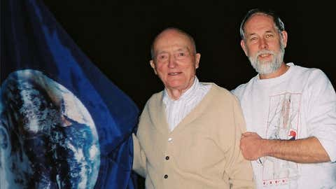 John McConnell and Robert Weir in 2005 with the original Earth Flag designed by McConnell. (Anna McConnell, courtesy Robert Weir)