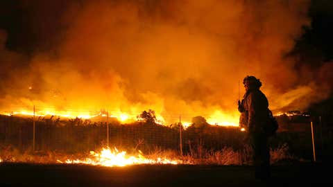 A firefighter monitors the Kincade Fire as it burns through the area on Thursday, October 24, 2019, in Geyserville, California. (Justin Sullivan/Getty Images)