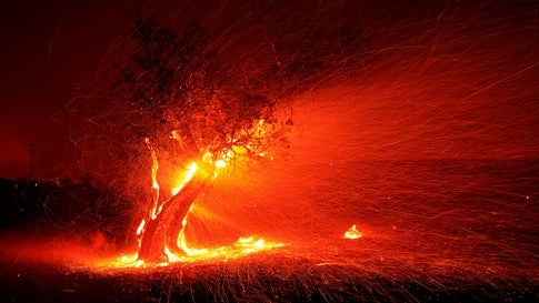 An ember wash spreads over the landscape pushed by high winds during the Kincade Fire on Thursday, October 24, 2019, near the town of Geyserville, California, in Sonoma County. (Kent Porter/The Press Democrat via AP)