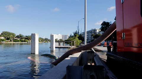 A temporary pumping station is set up along the Intracoastal Waterway to prevent flooding during a king tide, Saturday, September 28, 2019, in Miami Beach, Florida. Flooding threatens tens of thousands of septic tank systems in Miami-Dade County. (AP Photo/Lynne Sladky)