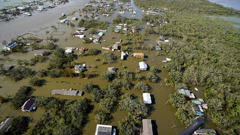 Homes are flooded in the aftermath of Hurricane Ida, on Monday, August 30, 2021, in Lafitte, Louisiana. (AP Photo/David J. Phillip)